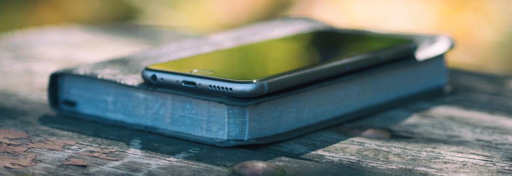 Bible with mobile phone